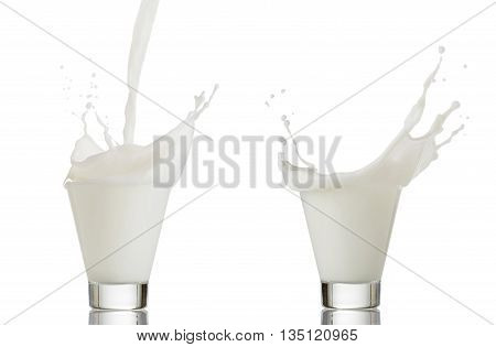 splash of milk in a glass isolated on white.