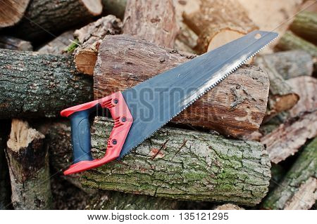 Saw in stump background chopped firewood outdoor