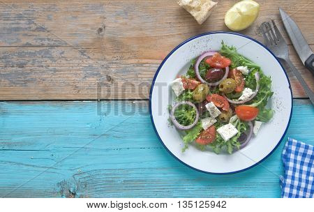 Freshly made greek salad with feta cheese and tomatoes