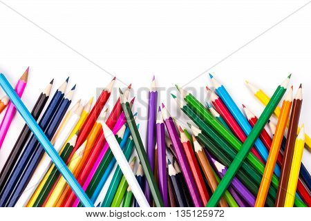 Color pencils topsy-turvy pile on white background