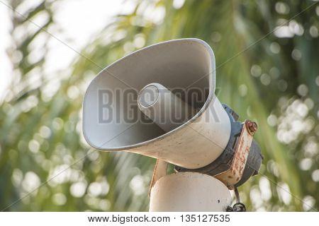 Megaphone loudspeaker blurry background in the park