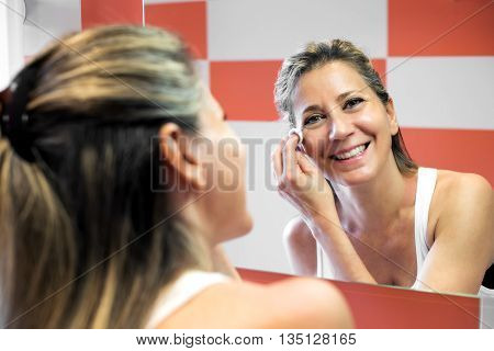 Smiling Attractive Woman Removing Her Makeup