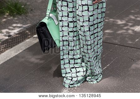 MILAN ITALY - JUNE 18: Detail of bag outside Jil Sander fashion show building for Milan Men's Fashion Week on JUNE 18 2016 in Milan.