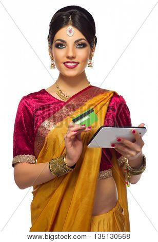 Indian young woman plastic card and tablet PC isolated