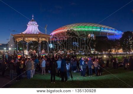ADELAIDE, AU - JUN 18, 2016: Hundreds of South Australians gather at Elder Park to remember the victims and demonstrate their support for the survivors of the recent Orlando Pulse nightclub attack.