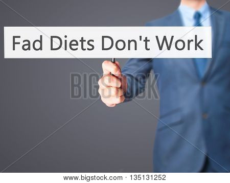 Fad Diets Don't Work - Businessman Hand Holding Sign
