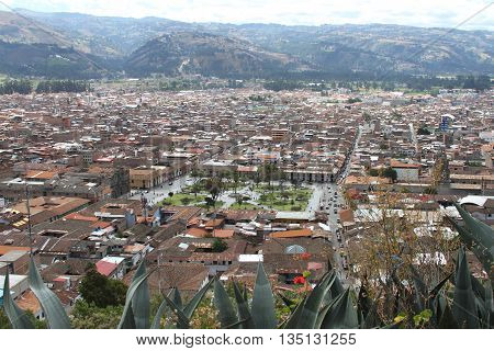 Cajamarca Peru - June 18 2016: Looking East from the Mirador Santa Apolonia over Cajamarca City Peru with the Plaza de Armas in the center and the hills surrounding the Cajamarca Valley in Cajamarca Peru on June 18 2016