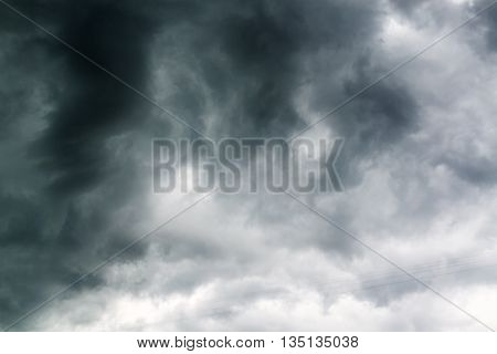Black stormy dramatic clouds in gloomy sky
