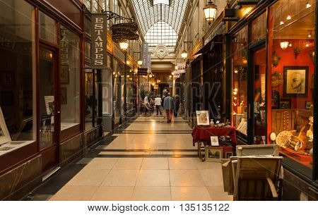 Paris France-June 18 2016 : The passage Verdeau was built in 1847. It is one of the most charming covered arcades in Paris with a lot of antique boutiques and unique shops.