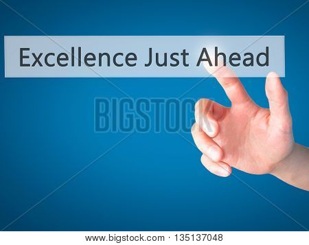 Excellence Just Ahead - Hand Pressing A Button On Blurred Background Concept On Visual Screen.