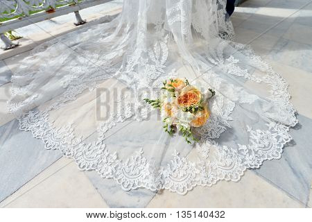 Beautiful Wedding Colorful Bouquet With Gown For Bride. Beauty Of Colored Flowers With White Dress.