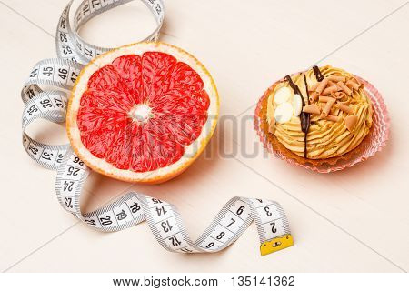 Grapefruit And Cake With Measuring Tape. Diet
