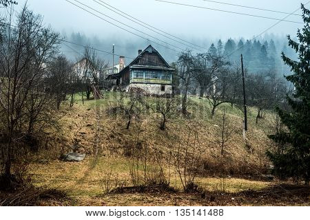 beautiful landscape with house on hill in Carpathians, Ukraine