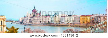 Vibrant spring panorama of Hungarian Parliament, Danube river, houses, Budapest, Hungary