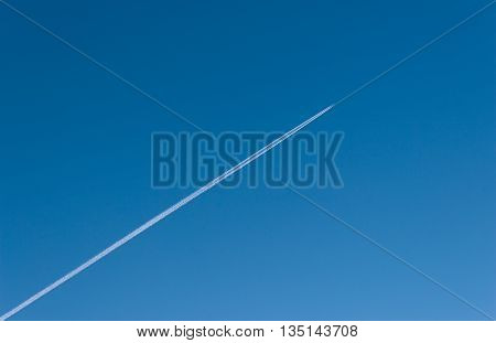 the trace of the plane in blue sky