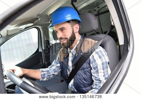Technician sitting in vehicle