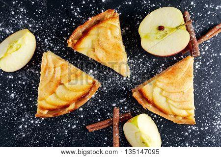 Slice of Golden Bramley apple tart with cinnamon glaze.