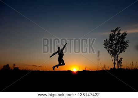 Silhouette of jumping man and beautiful sunset sky. Element of design. Business concept