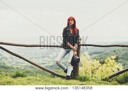 Beautiful woman with red hair posing in nature