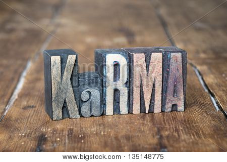 karma word made from wooden letterpress type on grunge wood