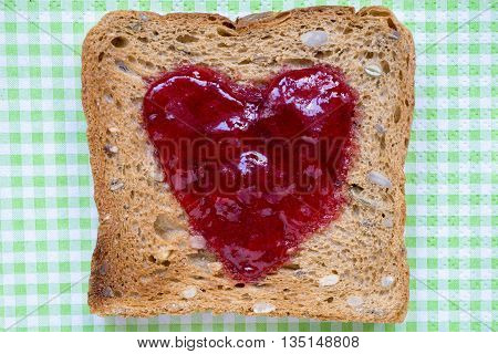 red jam toast on the green checkered napkin