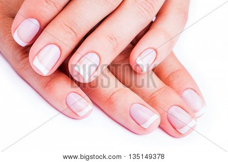 Woman hands with french manicure isolated on a white background