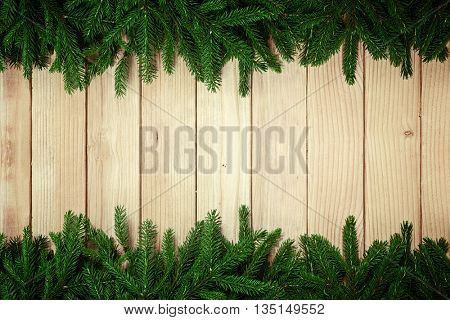Christmas fir tree branch decorations on wooden background