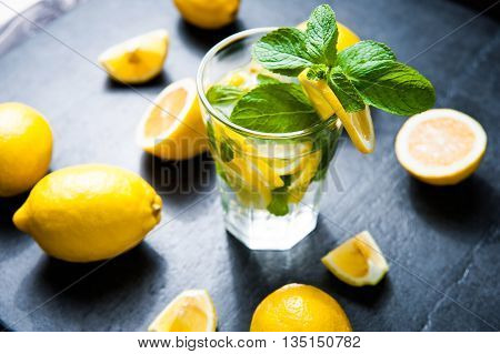 Refreshing cold lemonade, Cocktail on dark stone table. Top view