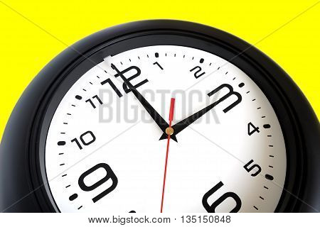 Fragment of big round wall clock, with a black rim isolated on white background close-up and arrows showing three o'clock isolated on yellow close-up