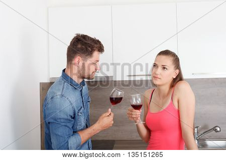 Young Couple With A Glass Of Red Wine.
