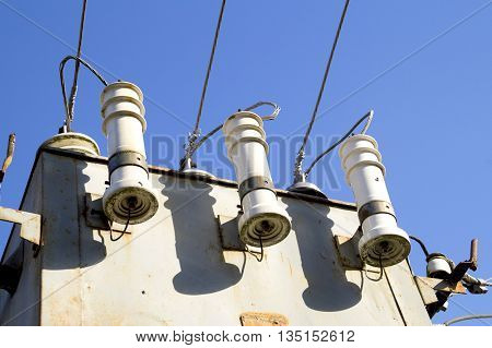 porcelain insulators of high-voltage substation on blue sky