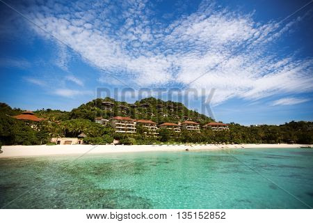 tropical beach with hotel chains on the coast