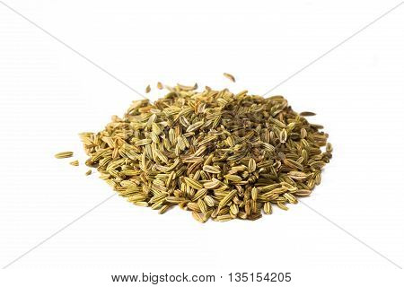 Heap of fennel seed isolated on white background closeup.