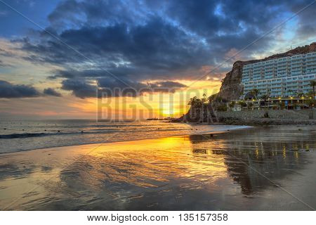 Atlantic beach of Gran Canaria island in Taurito at sunset, Spain