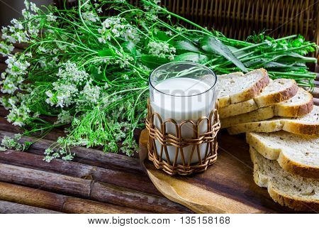 natural eco-products bread milk old wooden table rural composition rural lifestyle