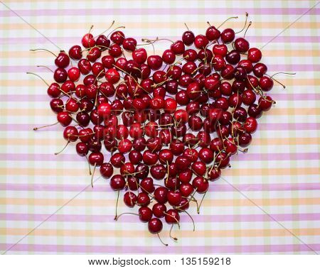 Fresh ripe berries cherries raspberries blueberries copy space background summer fruits harvest concept vitamins food heart shaped