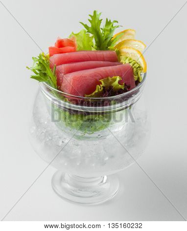 Salad With Red Fish With Lemon And Greens In A Bowl With Ice On A White Background