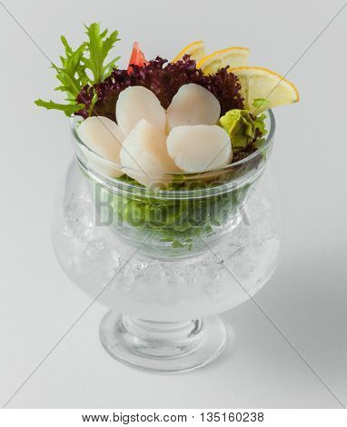 Salad Of White Fish With Lemon And Greens In A Bowl With Ice On A White Background