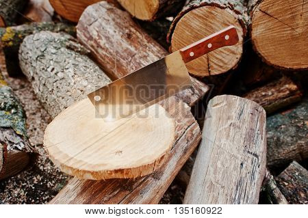 Kitchen Hatchet Knife Machete At Stump Background Chopped Firewood.