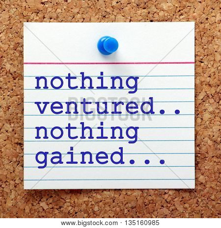 The phrase Nothing Ventured Nothing Gained on a note card pinned to a cork notice board as a reminder