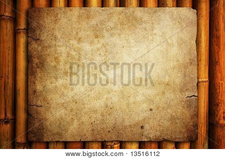grunge paper on bamboo background