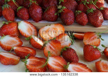 Juicy fresh strawberry cut on a chopping board
