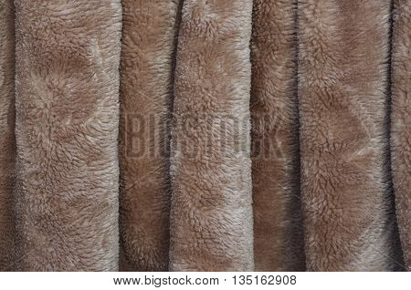 waves synthetic fleecy fabric texture beige wrinkled
