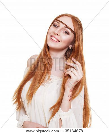 Fashion boho chic styled young woman with long red hair smiling, wearing white blouse with henna tattoo. Boho style girl. Modern stylish hippie. Ethnic natural cloth. Isolated, studio shot of model.