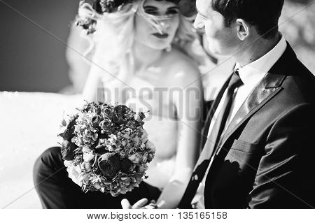 Close Up Portrait Of Charming Bride In A Wreath And Elegant Groom On Landscapes Of Mountains, Water