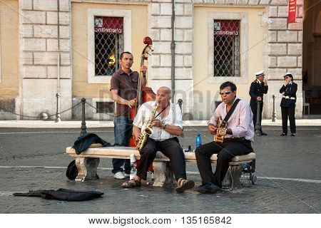 ROME, ITALY - MAY 12, 2012 - Street musicians playing on Navona square in Rome