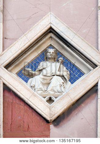 FLORENCE, ITALY - JUNE 05: Sun by Collaborator of Andrea Pisano, 1337-41., Relief on Giotto Campanile of Cattedrale di Santa Maria del Fiore, Florence, Italy on June 05, 2015