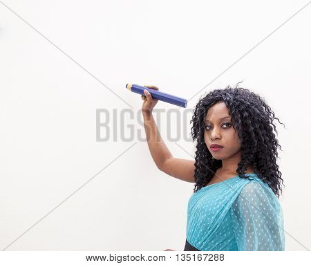 Young Businesswoman Wants To Draw Something On The Wall