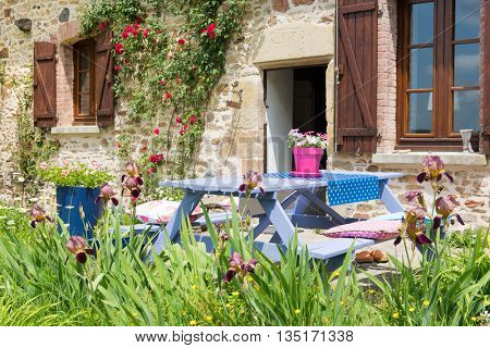 Colorful picnic table in the French garden