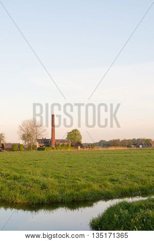 Dutch pumping station in polder landscape